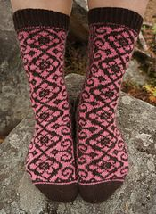 Keisarin morsian - The Emperor's Bride Socks is a toe up stranded pattern with a reverse riverbed gusset and a round heel turn. The length of the foot and/or leg is easily adjustable; the width can be adjusted by changing the gauge.