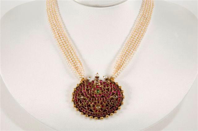 A Rakodi pendant with pearls