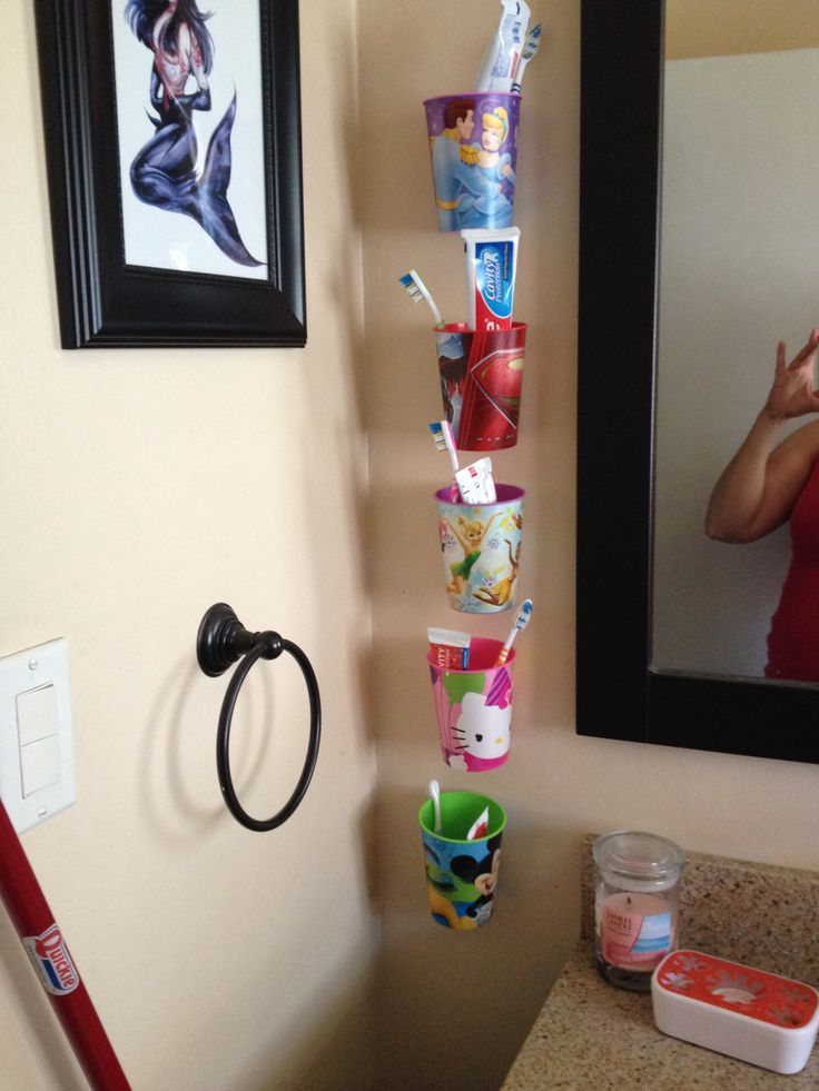 Kids toothbrush organization I used the scotch brand Velcro strips.