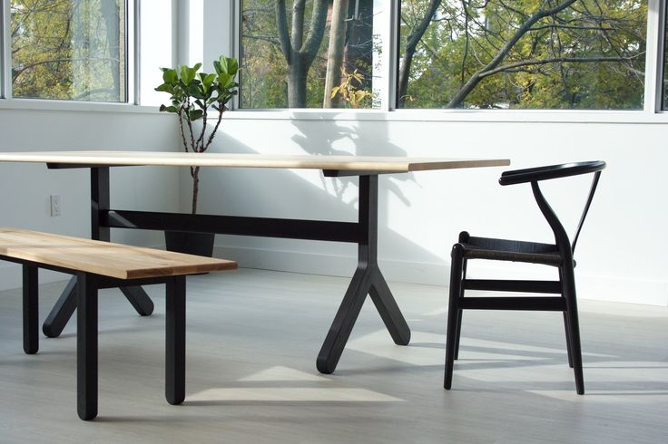 Modern solid wood dining table. Stir Trestle is a dining room table from KROFT's Stir Series collection