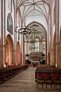 The new sacristy (1990s) in the 14th century Gothic Cathedral of Our Lady of the Immaculate Conception, Koszalin, Poland, is striking in its simplicity and sits in stark contrast to the cathedral itself.  How can the two live side by side in harmony?  The sacristy is underground.