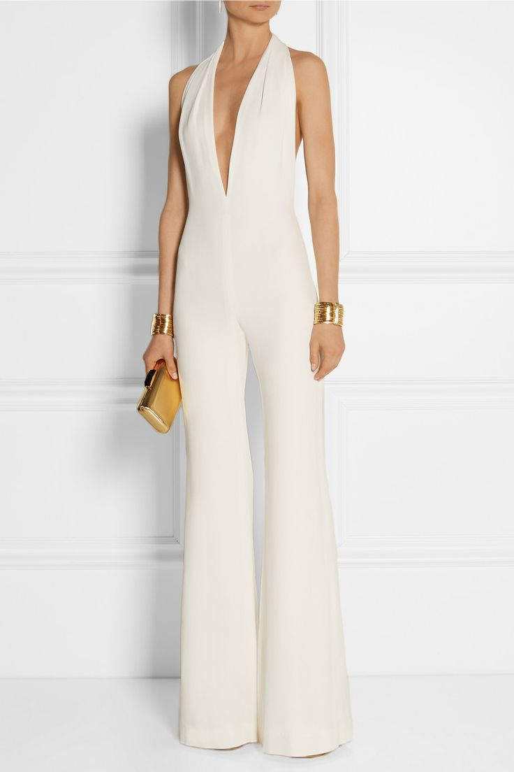 Balmain | Halterneck crepe jumpsuit | EDITORS' NOTES & DETAILS Balmain's white crepe jumpsuit embodies the label's rock-chic aesthetic. Designed with a daring low-cut front and open back, this halterneck style is balanced by a wide-leg silhouette that feels retro and cool. Team yours with towering platform sandals for the full effect.