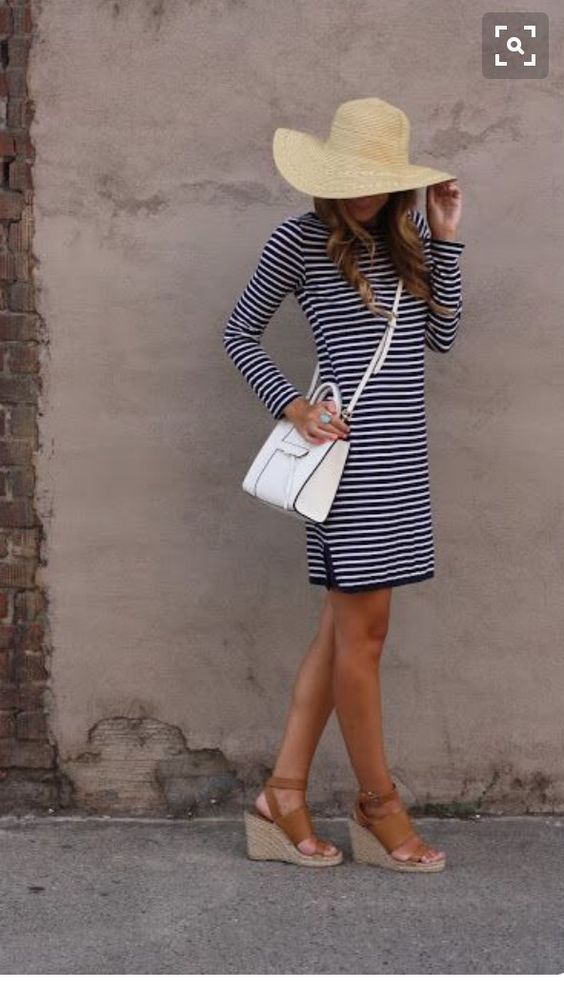 Spring 2016 stitch fix navy and white striped dress with white purse straw hat and neutral espadrilles. Resort wear.