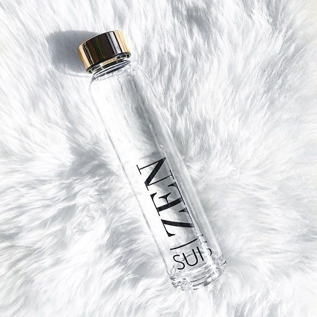 Rug up and hydrate. Shop our beautiful ZEN glass water bottle featured here with a real gold plated lid. Interior design love. Simple luxuries. All white.