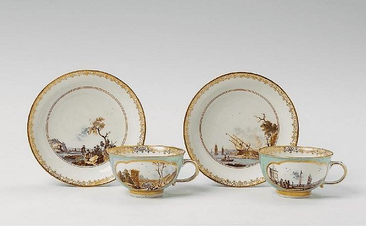 A gold and turquoise ground Meissen cup and saucer, the reserves painted with European landscapes. Crossed swords mark, Dreher´s mark to cup, impressed 2 to saucer, gilt 22. to cup and saucer. Handle re-attached, a retouching to the gold ground. Circa 1740.