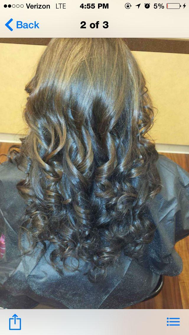 Dark brown hair with mocah highlights/toner.