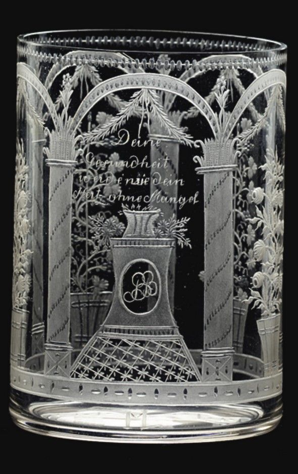 A fine North Bohemian engraved beaker Franz Anton Riedel, Isergebirge, circa 1805 the cylindrical form decorated in matt and klarschnitt with five arched panels and columns, one enclosing a pedestal bearing the monogram PB, supporting a basket of flowers, inscribed above Deine Gerundheit werde wie dein Hertz ohne Müngel, the initial M below, the other panels with tubs of roses and berried vines, within a dotted border 10.7cm., 4½in.