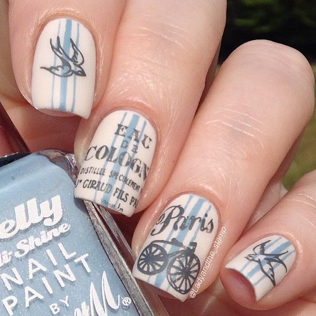 """Oooo look my little Paris bicycle has made a comeback! I did some ticking effect (is that what it's called?) with my new found striping tape skills, using @barrymcosmetics Coconut and Elderberry, and stamped with @mundodeunas Dark Grey with Cheeky jumbo plate 3, and @messymansion MM14 and MM18. I added some matte topcoat to complete my French shabby chic look!"""