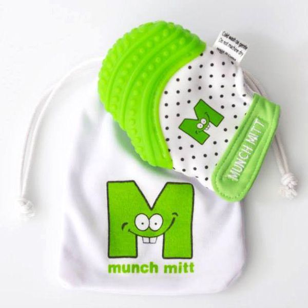 Munch Mitt Baby Teething Mitten l 6 | TheMunch MittBaby Teething Mitten. It features a textured flexible surface that provides soothing teething relief, plus it'll keep little ones entertained with itscrinkly noise and stimulating black & white pattern. It's made from food grade silicone and is BPA and phthalate-free.Available for purchase atAmazon.