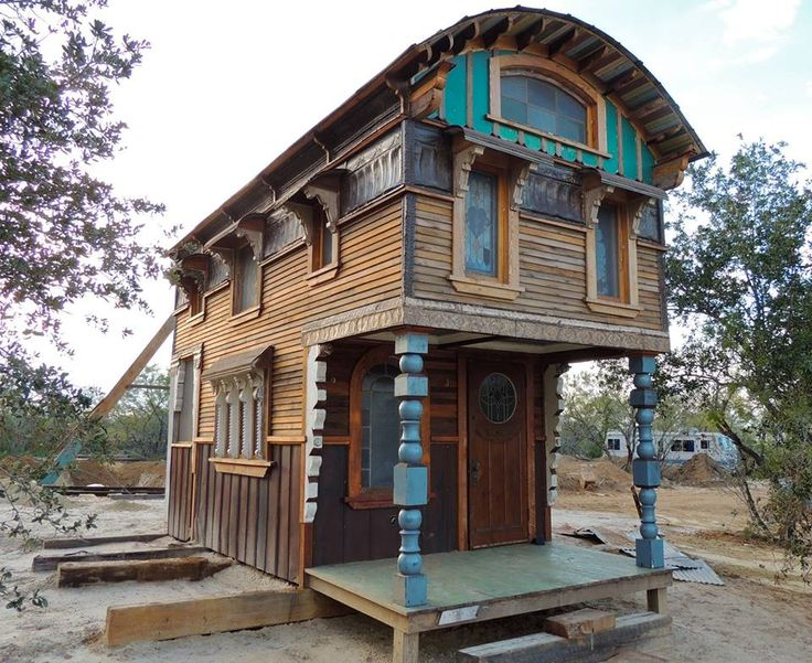Love the curved roofline and pillars in the front of this Tiny home .. the Temple Tantra by Brad