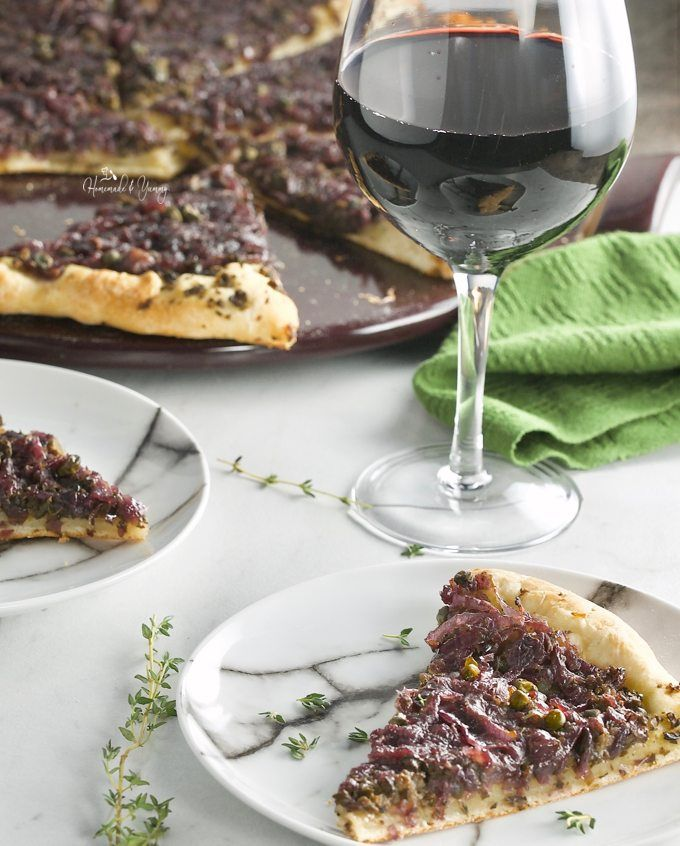 Pissaladiere French Pizza with Onion Olive Tapenade. Caramelized onions, olive tapenade, capers and fresh thyme. Simple ingredients, sensational flavour.