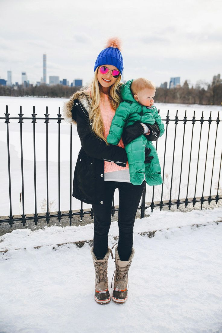 Amber of Barefoot Blonde is one of the most stylish mommies out there. Follow in her snowy footsteps, and create a look that's perfect for winter's cold weather. A beanie, a parka, and snow boots create an ideal outdoors look.