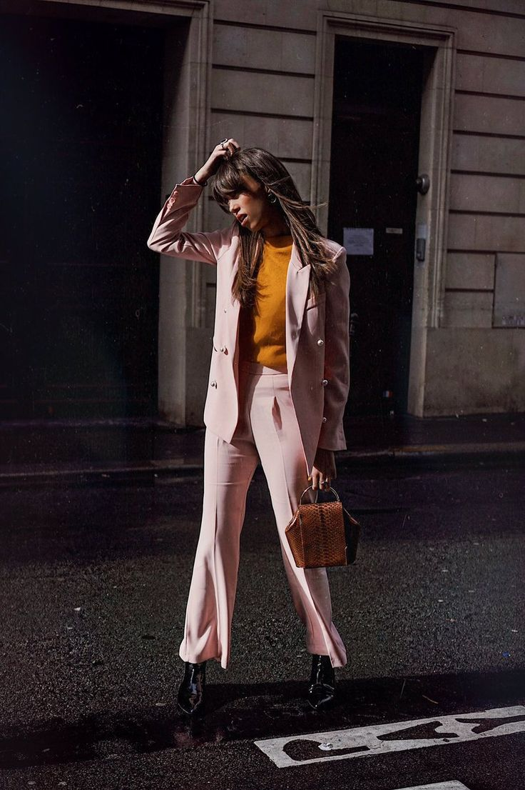 Thania Peck with a pink outfit wearing Onesixone at Paris Fashion Week #onesixonebag