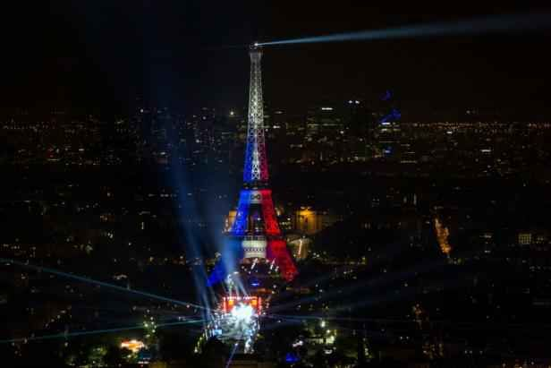 Photo of the Eiffel Tower in the colors of France, taken on 9 June 2016.