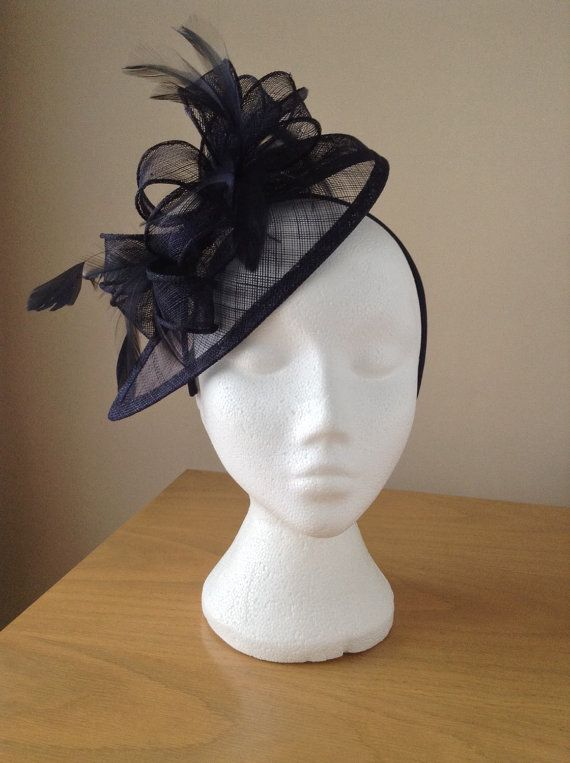 This lovely elegant navy blue/midnight blue fascinator is made on a teardrop base of sinamay, which has sinamay curls and coils, navy blue coque