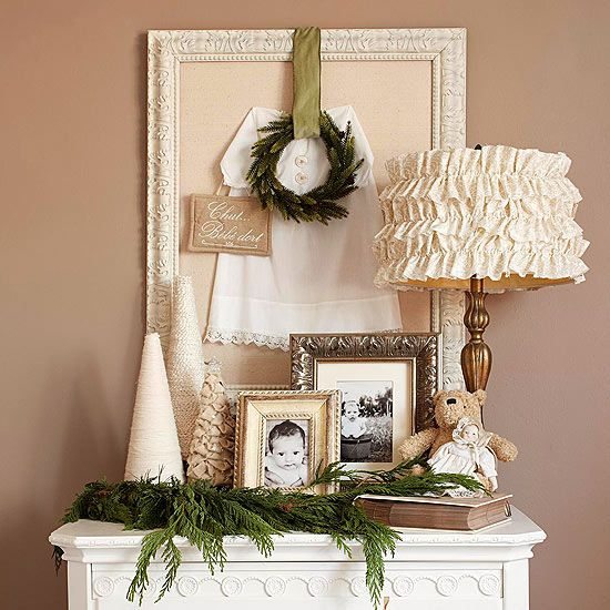 • Garlands in Different Rooms | There's no reason to limit your use of garland -- however casual -- to just your living spaces. If you have extra pieces of evergreen boughs, add unexpected texture and rich color to bedside tables, bathroom shelves, and more. Here, a casual arrangement -- mini garland on the table, mini wreath hung from a frame -- creates a charming vignette in a spare bedroom.