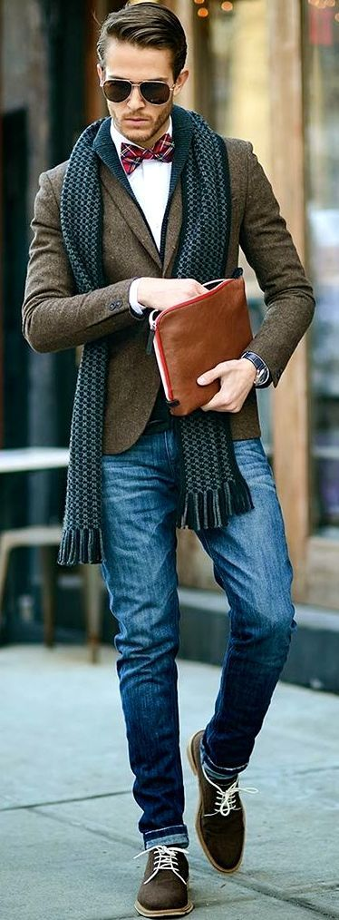 Men's Dark Brown Suede Derby Shoes, Navy Jeans, Charcoal Scarf, Dark Brown Wool Blazer, Red Plaid Bow-tie, White Dress Shirt, Charcoal Shawl Cardigan, and Dark Brown Sunglasses