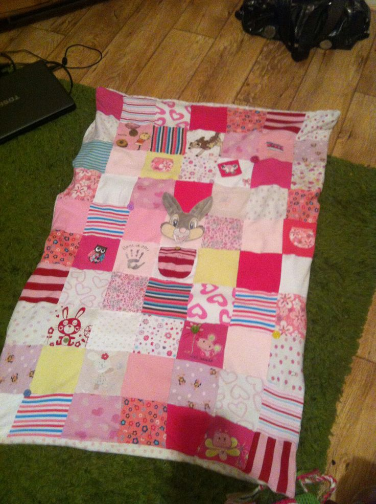 Blanket made from baby clothes.