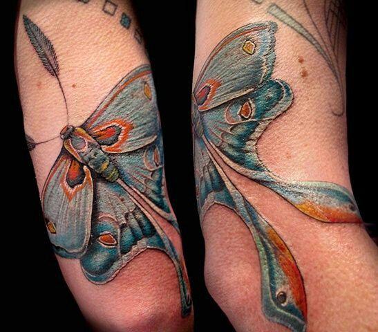 Blue moth tattoo