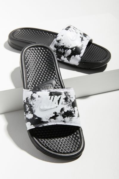4cfb62c3d603 Shop Nike Benassi JDI Printed Slide at Urban Outfitters today. Discover  more selections just like this online or in-store. Shop your favorite  brands and ...