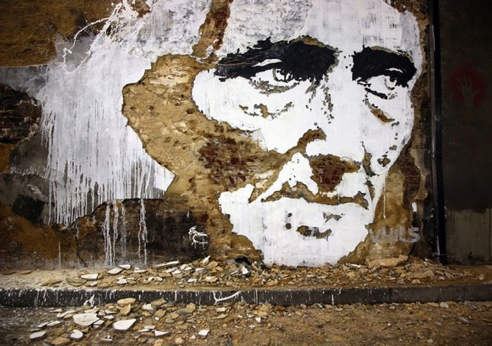Alexandre Farto aka Vhils | Street Art.Vhils creates graffiti by scratching walls, ripping up old billboards, etching metal, stencil and painting paper and timber, including a number of installations using lights, steel boxes, spray cans, paint, bleach and more.