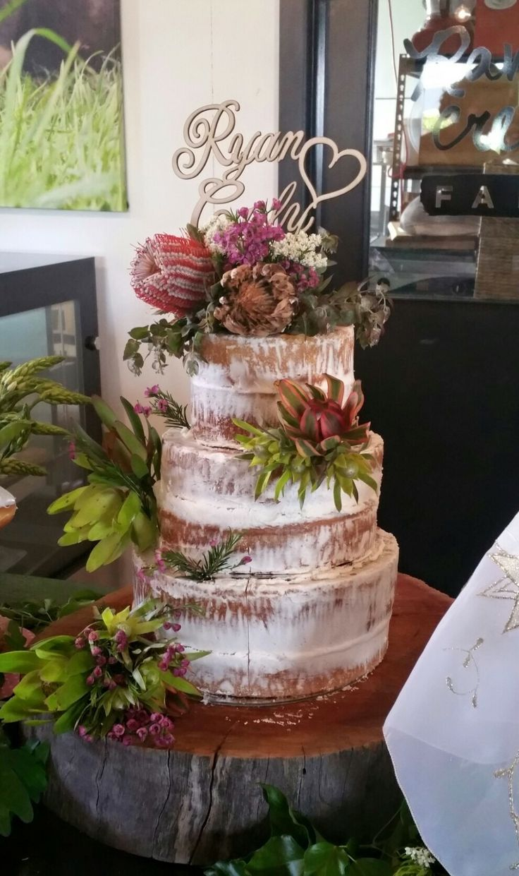Our beautiful naked wedding cake by mad cakes. With personalised name from etsy! Surrounded by a doughnut station