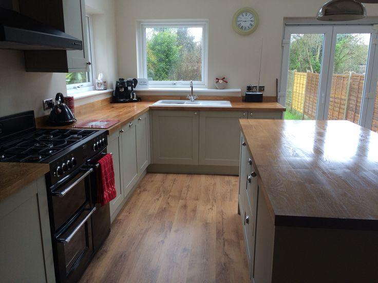 Kitchen island; Amersham grey units, belling range cooker, solid oak worktops