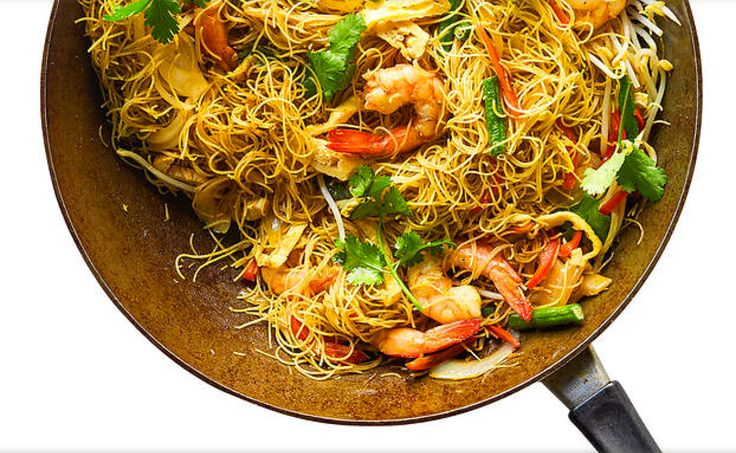 Singapore Noodles - Dry with a punch of curry flavour, this noodle dish is a stalwart of the Asian takeaway food scene. It's also simple to make at home! http://www.sbs.com.au/food/recipes/singapore-noodles