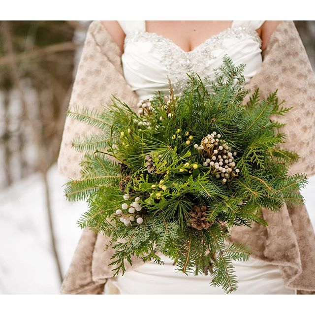 A beautiful winter bouquet of greens and pine cones wrapped in birch bark. Not every bouquet needs to be filled with flowers.  @incarnationsdesign
