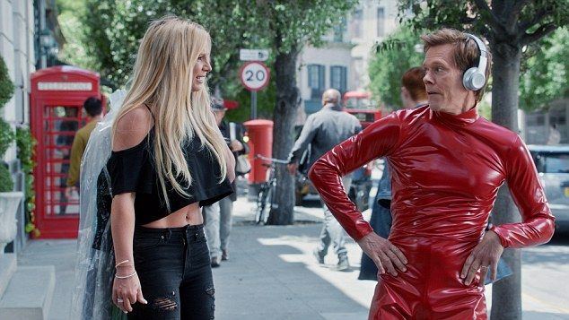 What you looking at? Dancing to 'Oops, I Did It Again' while dressed in a copy of the singer's famous red catsuit, Kevin will no doubt have audiences in stitches