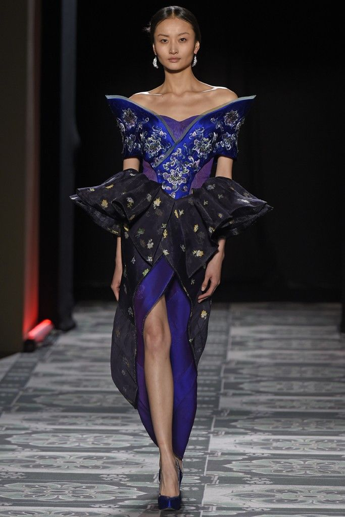 Laurence Xu added touches of modernity to his embellished red carpet wear for couture.  [Photo by Giovanni Giannoni]
