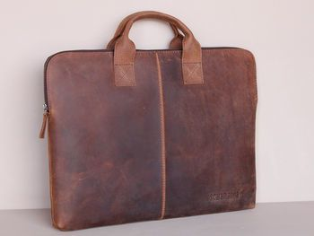 Scaramanga portfolio case with handles - not just a beautiful, slimline design, but ethically made from leather that's tanned with fewer chemicals - http://www.workfromhomewisdom.com/product-reviews/laptop-bag-reviews/scaramanga-portfolio-case-with-handles/