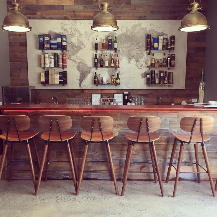 The whisky bar at the Mclaren Vale Distillery with wood panel feature wall & industrial pendant lighting