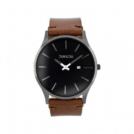 Koop dit DUKUDU Baldur Bruin/Zwart horloge DU-005 horloge online in onze webwinkel.                     Dit is een heren horloge met een quartz uurwerk.                             De kleur van de kast is zwart en de kleur van het uurwerk is zwart.                             De kast is gemaakt van rvs en de band van het horloge van leer.                             Het uurwerk is analoog en er wordt gebruik gemaakt van mineraalglas.                                       Wij zi...