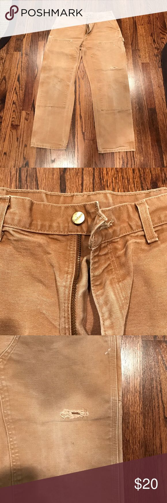 Men's Carhartt work pants Men's genuine Carhartt work pants. Slight rip in the knee, but has been repaired and reinforced. Carhartt Pants Cargo