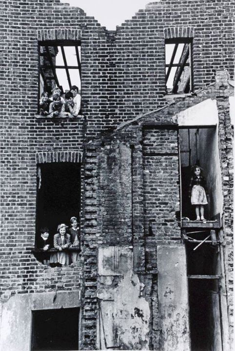 Children playing in a building bombed during the war, Bermondsey, London, 1954.