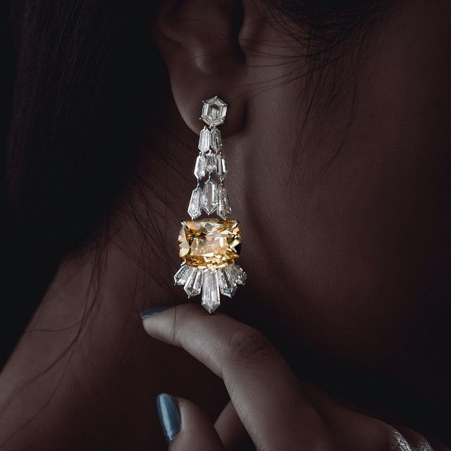 A pair of diamond earrings by FORMS.