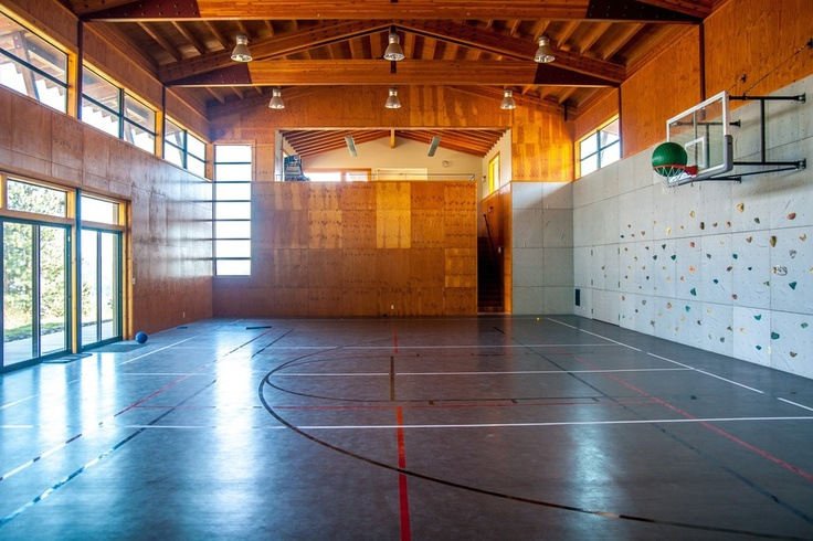 Private Indoor Sport Court With A Rock Wall And Attached