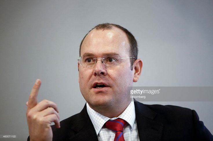 Graham Shuttleworth, chief financial officer of Randgold Resources Ltd., gestures as he speaks during the company's fourth-quarter results presentation in London, U.K., on Monday, Feb. 9, 2015. Randgold Chief Executive Officer Mark Bristow said today that the company is 'ready to pull the trigger' on any acquisition opportunities. Photographer: Simon Dawson/Bloomberg via Getty Images