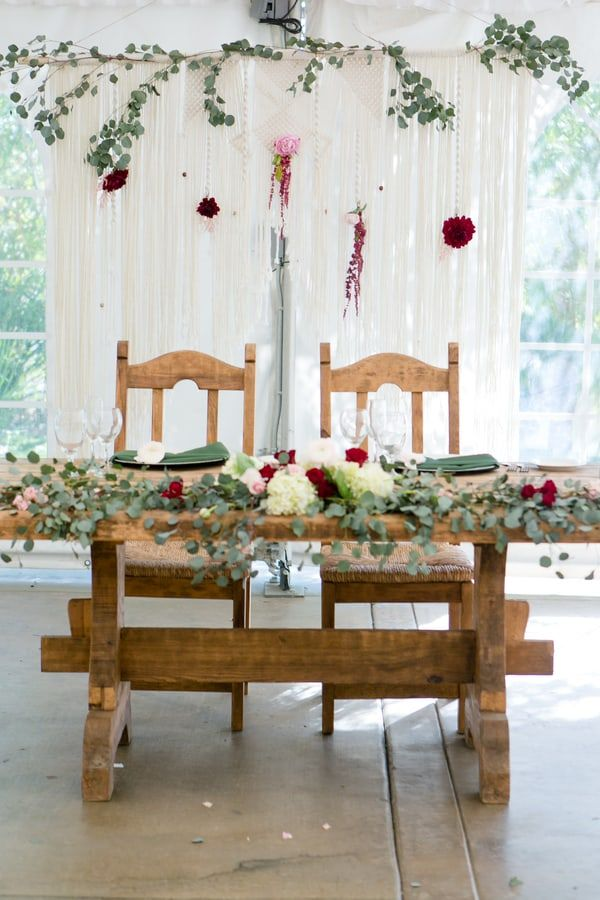 Tented Wedding Reception Bride And Groom Table With Greenery Table