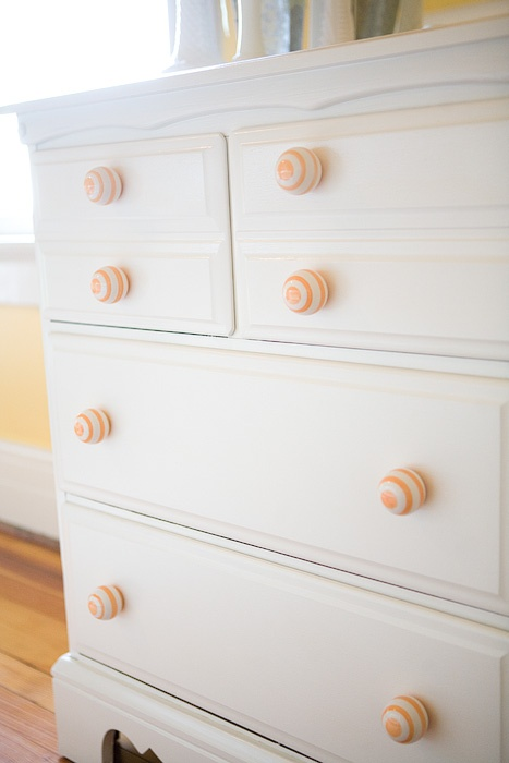 My kids bedroom/Mixed gender. Dresser repurposed by 508 Design from maple with black metal pulls to white with striped knobs!