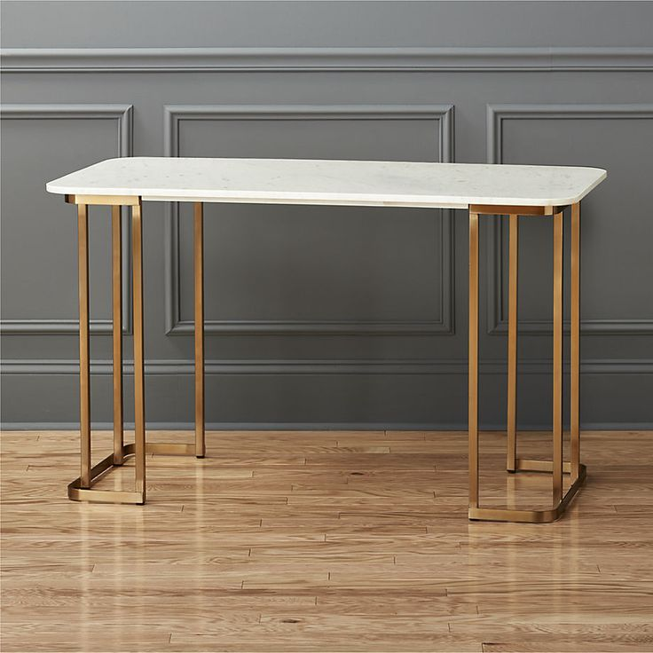 major promotion.  This beauty just might have you volunteering for a little weekend work.  Old-world elegance of white Banswara marble works a modern angle on a brilliant brass base.  A cue to its quality, hi-gloss lacquer is hand-applied to the frame for an ultra-polished finish.  Both modern and timeless, desk is an instant heirloom.