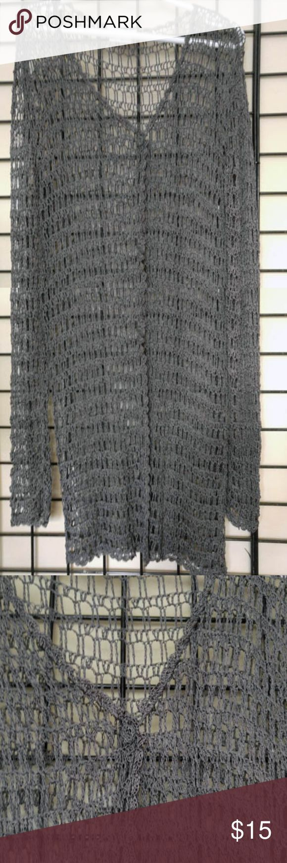 Open Work Crochet Silver Cardigan Beautiful Gunmetal Silver cardigan. Looks great with skirts, pants or over a sleeveless dress. Long sleeve, single button closure. Excellent condition. Sweaters Cardigans