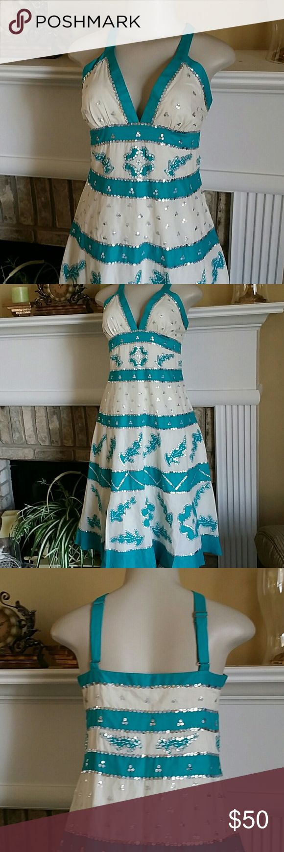 BEAUTIFUL BCBG MAXAZRIA DRESS Teal blue and white with sequin details.  Fully lined.  Adjustable  straps. Perfect for spring/summer. Gently used.  Tiny yellow stain hardly  noticeable  as shown on last picture. BCBGMaxAzria Dresses