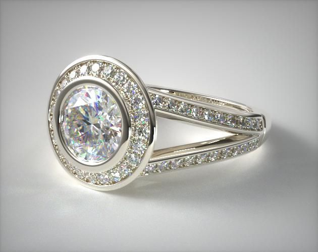 SKU 49521 - Stunning and timeless! This bezel set diamond halo features an exquisitely turned wire detailing under the diamond. A channel set pave split shank completes the elegant feel of this engagement ring. *Please allow additional time for fancy shape diamonds and gemstones.*
