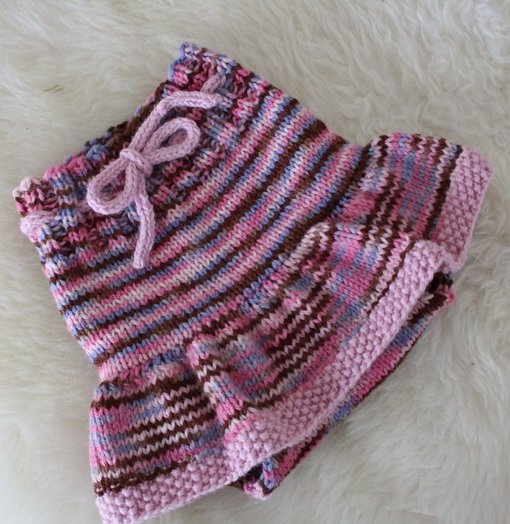 Free Knitting Pattern for Ruffle Skirted Soaker - Baby diaper cover designed by Petra Hoy. Pictured project by Totette who added a seed stitch hem.