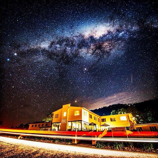 A stunning display by the Milky Way over the Lufra Hotel, near Eaglehawk Neck on the Tasman Peninsula. The Neck - a narrow land-bridge to the Tasmanian Peninsula - was once guarded by a line of chained dogs to prevent convicts from escaping the notorious prison settlement at Port Arthur. These days it's a natural gateway to the remarkable history and geological wonders of the region. #discovertasmania #tasmania #tasmannationalpark #eaglehawkneck Image Credit: Francois Fourie