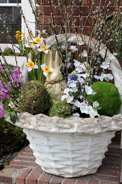 If it's still a bit too chilly to plant. This cute arrangement in a planter will brighten up the front porch.