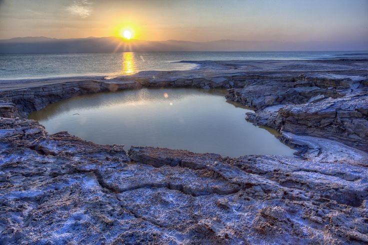 Dead Sea Sunrise - Sunrise over the Dead Sea, with a giant sinkhole in the foreground.