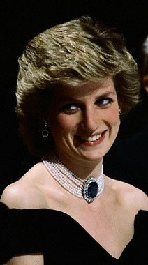 The seven-strand pearl choker that stunned the world. This magnificent choker with a large sapphire with two rows of diamonds surrounding it was originally a brooch. It was given to the Princess by Queen Elizabeth the Queen Mother as a wedding gift. The Princess wore it as a brooch on two occasions but had it altered to a choker. She wore it in Washington D.C. on November 9, 1985 when she danced with John Travolta at The White House. She also wore it with her black 'revenge' dress in 1995.